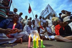 DMK supporters gather near the Kauvery Hospital, in Chennai on Tuesday, Aug 7, 2018. Party chief M Karunanidhi passed away at the hospital after a prolonged illness.