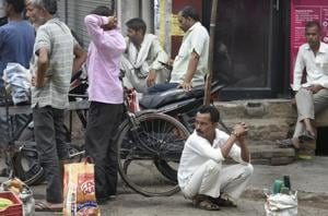 Daily wage labourers wait to be hired at a 'labour chowk' in Kalyan Puri on Tuesday, August 7, 2018.
