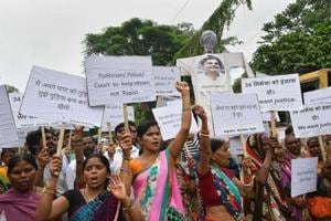 Bahujan Azad Party workers shout slogans during a protest against Muzaffarpur shelter home rape case, in Patna on August 7, 2018.