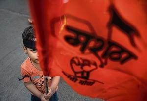 Members of the Maratha community gathered outside the collector's office in Bandra on Thursday.