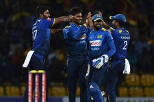 Sri Lankan cricketer Dhananjaya de Silva (2ndL) celebrates with teammates after he dismissed South Africa