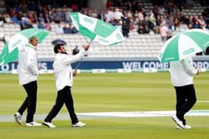Cricket - England v India - Second Test - Lord's, London, Britain - August 9, 2018 Umpires Jeffrey Crowe, Aleem Dar and Marais Erasmus check the condition of the pitch during a rain delay