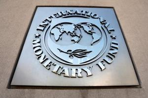 International Monetary Fund logo is seen outside the headquarters building during the IMF/World Bank spring meeting in Washington, US.