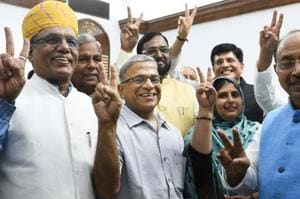 BJP candidate Harivansh Narayan Singh (C) shows victory sign after filling his nomination for the post of Rajya Sabha deputy chairman during Monsoon Session of Parliament, in New Delhi, India, on Tuesday, August 7, 2018.