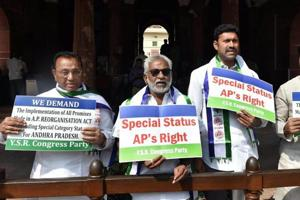 YSR Congress leaders hold placards demanding special status for Andhra Pradesh during the Parliament session in New Delhi.