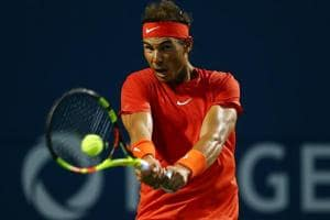 Rafael Nadal of Spain plays a shot against Benoit Paire of France at the Rogers Cup tennis tournament.