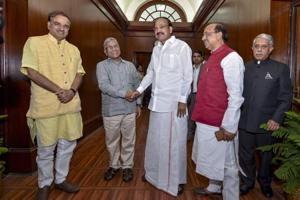 Newly-elected deputy chairman of Rajya Sabha, Harivansh Narayan Singh (second left), is greeted by vice president M Venkaiah Naidu at Parliament, in New Delhi.