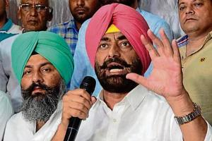 Aam Aadmi Party leader Sukhpal Singh Khaira addressing  a press conference in Amritsar on Thursday.