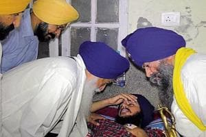 Akal Takht jathedar Giani Gurbachan Singh interacting with a victim of alleged custodial torture at Government Rajindra Hospital in Patiala on Thursday.
