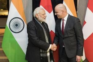 Swiss Federal President Alain Berset, right, and Prime Minister Narendra Modi, shake hands prior to a meeting one day before the start of the 48th annual meeting of the World Economic Forum, in Davos in January.