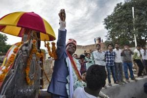Sanjay Jatav, 27, sits on a buggy, escorted by the police as he reaches with the wedding procession (Baraat) to Nizampur, in Kasganj, Uttar Pradesh. Sanjay Jatav, took out a wedding procession in UP's Kasganj to defy caste prejudice.