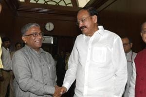 Newly-elected deputy chairman of the Rajya Sabha Harivansh Narayan Singh (left) is greeted by vice president M Venkaiah Naidu in Parliament, in New Delhi, on August 9, 2018.