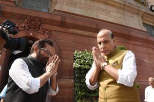 Home minister Rajnath Singh with Union minister Mukhtar Abbas Naqavi at Parliament House, in New Delhi.