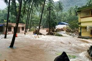 A view of a residential area following a flash flood, triggered by heavy rains, at Kodencheri in Kozhikode district of Kerala on Thursday, Aug 9, 2018.