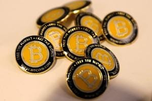 Bitcoin.com buttons are seen displayed on the floor of the Consensus 2018 blockchain technology conference in New York City, New York, US