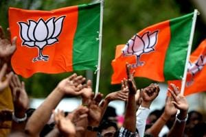 Supporters of Bhartiya Janta Party wave party flags on Amit Shah's arrival in Chennai on July 9, 2018.
