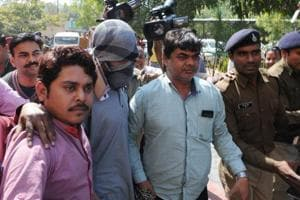 Suspected Islamic State operative, Azhar Iqbal (face covered), was arrested by the NIA in 2016. The central agency has roped in scholars to understand reasons for radicalisation.