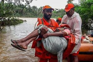 NDRF personnel rescue the flood-hit people in Wayanad, Kerala on Saturday, August 11, 2018.