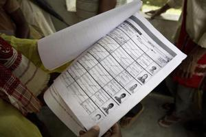 A man whose name was left out in the National Register of Citizens (NRC) draft, looks at the form he had earlier filled as he stands to receive forms to file an appeal in Mayong, near Guwahati.