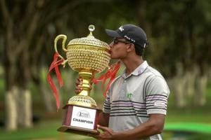 Bengaluru: Indian golfer Viraj Madappa kisses the trophy after winning of the Take Solutions Masters, Asian Tour Championship held at the Karnataka Golf Association in Bengaluru.