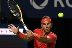 Aug 11, 2018; Toronto, Ontario, Canada; Rafael Nadal of Spain plays a shot against Karen Khachanov of Russia (not shown) in the Rogers Cup tennis tournament at Aviva Centre