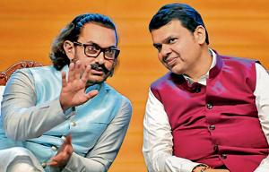 Aamir Khan (left), Bollywood actor and founder of the Paani Foundation, and Devendra Fadnavis, chief minister, during the Water Cup award distribution ceremony at Balewadi Sports Complex on Sunday.