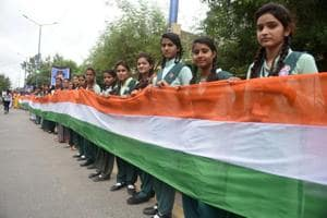 Students hold a tricolour which is said to be 12-km long, ahead of Independence Day, in Indore on Sunday. Uttar Pradesh Shia Waqf Board has told all madrassas functioning from its properties to celebrate the Independence Day by chanting 'Bharat Mata Ki Jai' after hoisting the national flag and singing the national anthem.