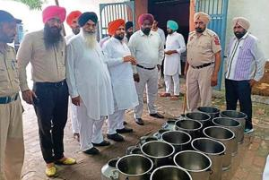 Jasmail Singh Laddi Gehri (fourth from left), husband of Congress MLA from Ferozepur (rural) Satkar Kaur, during his unauthorised visit to the central jail on Friday.