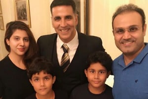 Virender Sehwag and his family poses with Akshay Kumar at Gold screening.