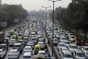 Vehicles move slowly at a traffic intersection in New Delhi.
