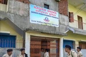 Police personnel investigate the site of Aasra shelter home after the death of two women inmates under mysterious circumstances in Patna on Sunday.