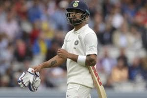 Virat Kohli leaves the pitch after he is caught by England