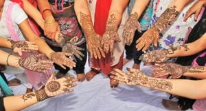 Women in Delhi-NCR get their hands beautified with mehendi, for Teej celebrations.