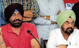 Aam Aadmi Party leaders Sukhpal Khaira and Kanwar Sandhu at a press conference in Chandigarh on Monday.