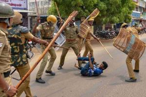 Police personnel baton charge at a protestor demanding the closure of Sterlite Copper unit, in Tuticorin.