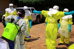Congolese and World Health Organization officials wear protective suits as they participate in a training session against Ebola virus near the town of Beni in North Kivu province of the Democratic Republic of Congo.