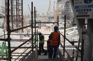 This file photo shows workers on the construction site at Al-Wakrah Stadium in Qatar.