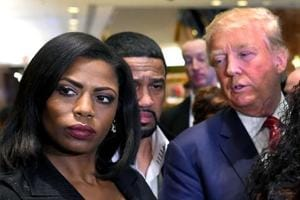 Omarosa Manigault Newman (left) appears alongside Donald Trump (right) during a press conference in New York.