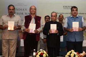 (L-R)Congress leaders Anand Sharma, Abhishek Manu Singhvi, former President Pranab Mukherjee and Union minister Nitin Gadkari at the book launch.