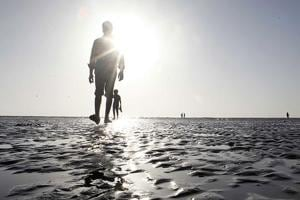 A man goes for a walk on Juhu beach, which is part of the Greater Mumbai territory.