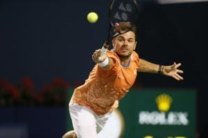 Stan Wawrinka (SUI) stretches to return a ball to Rafael Nadal in the Rogers Cup tennis tournament.