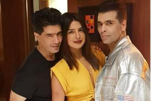 Manish Malhotra in company of Priyanka Chopra and Karan Johar.