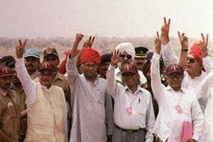 FILE - In this May 20, 1998 file photo, from left, Indian Prime Minister Atal Bihari Vajpayee, Defense Minister George Fernandes, founder of the Indian nuclear program Abdul Kalam, and Atomic Energy Chief R. Chidambaram display the victory symbol during a visit to the Shakti 1 test site, where India tested nuclear devices a week earlier, in Pokhran, India.