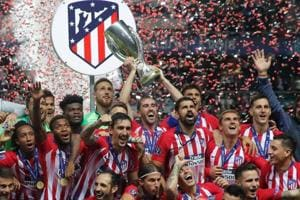 Soccer Football - Super Cup - Real Madrid v Atletico Madrid - Lillekula Stadium, Tallinn, Estonia - August 15, 2018 Atletico Madrid celebrate with the trophy after winning the Super Cup