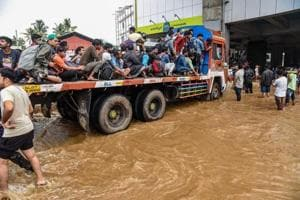 People being rescued from a flood-affected region following heavy monsoon rainfall, in Kochi.