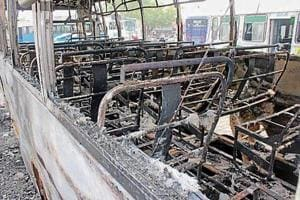 A bus torched during a flare-up after a Quran sacrilege incident at Malerkotla in 2016