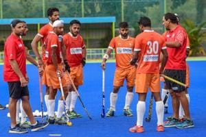 File photo of Indian men's hockey team players with coach Harendra Singh during a practice session.