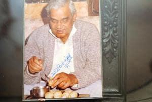 Atal Bihari Vajpayee savouring Kolkata's signature street snack phuchka at the Beriwala house. He also autographed the photo.