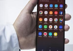 A Samsung employee displays the new Samsung Galaxy Note 9 smartphone during a product launch event at the Barclays Center. (Representative image)