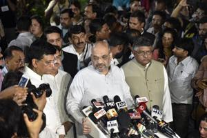 BJP President Amit Shah addresses the media after the convoy carrying the mortal remains of former prime minister Atal Bihari Vajpayee arrives at his Krishna Menon Marg residence, in New Delhi on Thursday, Aug 16, 2018.